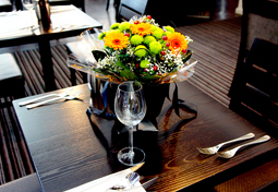 Example of a table with 2 Covers and 1 small Floral arrangement.